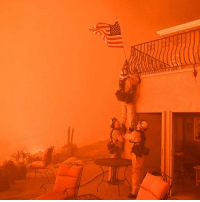 Bad, Children, and Fire: 10 JUL: Fire fighters remove a US flag as flames close in on a home in Oroville, California. A combination of high temperatures and parched land has added to the difficulties of firefighters. About 17 fires fanned by strong winds are raging across the length and breadth of the US state, all in different stages of containment. The fires are especially bad in Santa Barbara County where one is spanning an area of more than 35 sq mi (93 sq km). Thousands of firefighters were deployed, from the Six Rivers National Forest in the north to the San Bernardino Forest east of Los Angeles. Several injuries have been reported and numerous homes destroyed. Forecasters have warned that temperatures are likely to remain high with the elderly and children in particular danger. Air quality is reported to be noticeably poorer in areas inland from Los Angeles. California is regularly hit by wildfires at this time of the year. PHOTO: JOSH EDELSON-AFP BBCSnapshot photojournalism photography fires wildfires flames california firefighters
