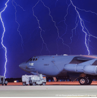 INCREDIBLE: Lightning strikes behind a B-52H Stratofortress at Minot Air Force Base, in North Dakota.: 1007  U.S. Air Force photo/Senior Airman J.T. Armstrong INCREDIBLE: Lightning strikes behind a B-52H Stratofortress at Minot Air Force Base, in North Dakota.