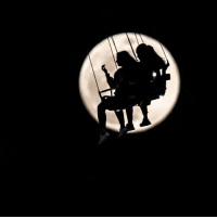 "Memes, Canada, and Fish: 11 APR: Two women are silhouetted against the full moon as they take a ride on the ""Jules Verne Tower"" merry-go-round at the Dippemess fair in Frankfurt, Germany. Although April's full moon is known as the Pink Moon, don't expect it to look particularly pink! It's named after pink flowers called wild ground phlox, which bloom in early spring and appear throughout the United States and Canada. It is also called the Sprouting Grass Moon, the Egg Moon and the Fish Moon in other parts of the world. PHOTO: Frank Rumpenhorst -AFP BBCSnapshot photography moon merrygoround"