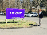 A friend of mine standing outside of his local Trump headquarters -Kayla: TRUMP  www. Donald Trump com  MAKE AMERICA GREAT AGAIN  E A friend of mine standing outside of his local Trump headquarters -Kayla