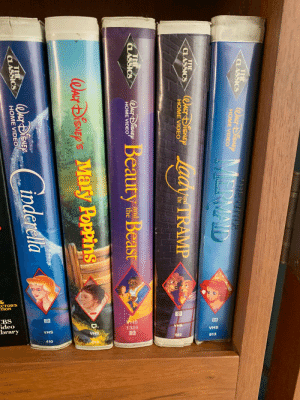 Is this a Disney plus I have this https://t.co/UMnGrgD4TT: 1325  CC  THE  CLASSICS  WACT SISAEP  NMERMAND  MMAME LWNNE  HOME VIDEO  THE  CLASSICS  7and  the  HOME VIDEO  THE  CLASSICS  OuiSlBeauty e Beast  and  the  HOME VIDEO  Whar DiSNEP'S Maly Poppins  CASSICS  HOME VIDEO Is this a Disney plus I have this https://t.co/UMnGrgD4TT