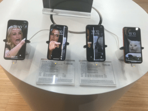 I walked into Apple and found this this person is a god: 18:10  18:10  18:10  18:10  Saturday 7 December  Saturday 7 December  Saturday 7 December  Saturday 7 December  Swipe up to open  iPhone 11 Pro  58nch Super Retina XDR OLED  - Water and dust resiatant (4 imetres lor up D 30 minutes. IPGay  Triple-cameera system with 12MP Ua Wide.  Wide and Telephoto cameras Night mode,  Portrait mode and 4K video up to 60 tps  12MP TrueDepth tront camera with Portrait mode,  4K videc and slo-mo  Face ID for secure authentication and Apple Pay  A13 Bionic chip with third-generation Neural Engine  Fast charge with 18W adapter included  IOS 13 with Dark Mode, new tools for editing photos  and video, and brand-new privacy features  iPhone 11  61-inch Liquid Retina HD LCO display  Water and dust resistant (2 metros for up to 30 minutes, IPO8)  Dual-camera system with 12MP Utra Wide and Wide cameras:  Night mode. Portrait mode, and 4K video up to 60 tps  • 12MP TrueDepth tront camara with Portrait mode.  4K video and slo-mo  Face ID for secure thentication and Apple Pay  A13 Blonic chip with third-goneration Neural Engine  Fast-charge capable  IOS 13 with Dark Mode, new tools tor editing photos  and video, and brand-new privacy features  From  From  1,049.00  $729.00  Capacity  64GB  128GB  Price  Finish  Capacity  Finish  Price  £729.00  2779.00  C879.00  Black. Green, Yellow, Purple, (PRODUCT)RED, White  Black, Green, Yellow, Purple, (PRODUCT)RED, White  Black, Green, Yeilow, Purple, (PRODUCT)RED, White  64G8  256GB  Space Grey, Silver, Midnight Green, Gold  Space Grey, Silver, Midnight n. Gold  Space Grey, Silver, Midnight  £1,049.00  £1,199.00  256GB  512GB  , Gold  £1,399.00  Thed ty otw  N ythe d ay has unded con Wen meud scne the Phone 11 en.cn ndwa degne  DC andant So nd dueatd w d ner rog ubory d  lan has lancn ue not pemarertconasons wd t mre dec  and vanesdn to met deor derng and uryg tdie oud unage NCove e w Mt  on the modend in P mally Ttonto 14G spas rcdng O ad t e  wa