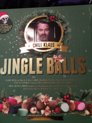 It's going to be a spicy advent: 19  11  15  WARNING  nd the skull please call  up! Behind this door  ind a serious treat, a  k so hot it breaks  22  any scale  24  CHILI KLAUS  18  o81  10  JINGLE BALLS  14  12  20  EVERY SPICE LEVEL IS IN PLAY HERE: SOME DAYS WILLOFFER ArirliPCE HEAT  AND ON OTHERS, YOU'LL FEEL NOTHING BUT A GEITLE BUR  NEW YEARS SJRPRISE: Lights your fire and provides a heute  Do not open door no. 31 before New lear's  21  17  16  13  WIND FORCE 1- 3-4  .2  L  00  3 It's going to be a spicy advent