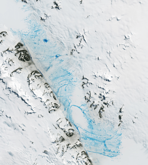 """19 January 2020: """"Even in frigid Antarctica, summer warmth can turn ice into water. At the peak of the 2019-2020 melt season, jewel-toned ponds of meltwater spanned a vast area on the George VI ice shelf—a huge slab of floating glacier ice attached to the western side of the Antarctic Peninsula."""": 19 January 2020: """"Even in frigid Antarctica, summer warmth can turn ice into water. At the peak of the 2019-2020 melt season, jewel-toned ponds of meltwater spanned a vast area on the George VI ice shelf—a huge slab of floating glacier ice attached to the western side of the Antarctic Peninsula."""""""