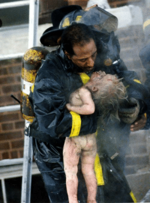 1988 Pulitzer Prize winner. Firefighter trying to revive a child.: 1988 Pulitzer Prize winner. Firefighter trying to revive a child.