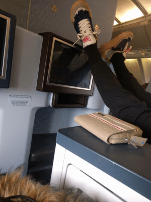 So much for upgrading to business class: 1OBLACES  No Stowage on Shelf or Ottoman  During Taxi, Takeoff and Landing  Life Vest Under Center Armrest  Fasten Seat Belt While Seated  Stow and Latch Handset for  Taxi, Takeoff and Landing So much for upgrading to business class
