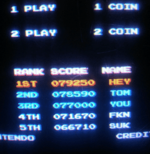 Mario, Mario Bros, and Score: 2 PLAN  2 COIN  STH 66710 SUK  TENDO  CREDI Some guy named Tom tried to challenged someones high score in Mario Bros.