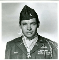 26 JANUARY 1945 American Lt. AudieMurphy, is wounded in France. Born the son of Texas sharecroppers on June 20, 1924, Murphy served three years of active duty, beginning as a private, rising to the rank of staff sergeant, and finally given a battlefield commission to 2nd lieutenant. He was wounded three times, fought in nine major campaigns across Europe, and was credited with killing 241 Germans. He was awarded 37 medals and decorations, including the Distinguished Service Cross, the Silver Star (with oak leaf cluster), the Legion of Merit, and the Croix de Guerre (with palm). The battle that made Murphy a recipient of the MedalofHonor, and which ended his army active duty, occurred during the last stages of the Allied victory over the Germans in France. Murphy acted as cover for infantrymen during a last desperate German tank attack. Climbing atop an abandoned U.S. tank destroyer, he took control of its .50-caliber machine gun and killed 50 Germans, stopping the advance but suffering a leg wound in the process. Upon returning to the States, Murphy was invited to Hollywood by Jimmy Cagney, who saw the war hero's picture on the cover of Life magazine. By 1950, Murphy won an acting contract with Universal Pictures. In his most famous role, he played himself in the monumentally successful To Hell and Back. Perhaps as interesting as his film career was his public admission that he suffered severe depression from PTSD, also called battle fatigue, and became addicted to sleeping pills as a result. This had long been a taboo subject for veterans. Murphy died in a plane crash while on a business trip in 1971. He was 46.: 26 JANUARY 1945 American Lt. AudieMurphy, is wounded in France. Born the son of Texas sharecroppers on June 20, 1924, Murphy served three years of active duty, beginning as a private, rising to the rank of staff sergeant, and finally given a battlefield commission to 2nd lieutenant. He was wounded three times, fought in nine major campaigns across Europe, 