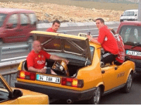 Liverpool fans en route to the Champions League final in Istanbul, 2005.: 34 TAH 28  34 BT 308 Liverpool fans en route to the Champions League final in Istanbul, 2005.
