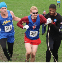 "In what is being described as ""an awesome display of sportsmanship and kindness,"" high school sophomore Jake Tobin stopped to help senior Luke Fortner after he fell during a cross country race in Auburn, N.Y. Fortner, who is legally blind, fell towards the end of the race but was assisted by Tobin and Jerry Thompson, his running aide.: 357  396 In what is being described as ""an awesome display of sportsmanship and kindness,"" high school sophomore Jake Tobin stopped to help senior Luke Fortner after he fell during a cross country race in Auburn, N.Y. Fortner, who is legally blind, fell towards the end of the race but was assisted by Tobin and Jerry Thompson, his running aide."