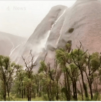 Australia's Ayers Rock is covered in cascading waterfalls after record-breaking rainfall, leaving six people missing.: 4 News Australia's Ayers Rock is covered in cascading waterfalls after record-breaking rainfall, leaving six people missing.