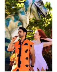 One last picture from the Flintstones photoshoot Red Kelly and I did a few months back. 📷 NOTE: That's an ACTUAL dinosaur behind us. Turns out, he's a big fan of my skits and wanted to get a picture to show his brother. Haters will say it's fake. True story. 😇: (7  扇. One last picture from the Flintstones photoshoot Red Kelly and I did a few months back. 📷 NOTE: That's an ACTUAL dinosaur behind us. Turns out, he's a big fan of my skits and wanted to get a picture to show his brother. Haters will say it's fake. True story. 😇