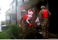 A rescue team from the North Carolina National Guard evacuates a family as the rising floodwaters from Florence threatens their home in New Bern, North Carolina.: 83  SERT  AP Photo/Chris Seward A rescue team from the North Carolina National Guard evacuates a family as the rising floodwaters from Florence threatens their home in New Bern, North Carolina.