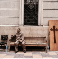 A man sits on a bench outside a church after a bomb attack in the Nile Delta town of Tanta, Egypt.: A A man sits on a bench outside a church after a bomb attack in the Nile Delta town of Tanta, Egypt.