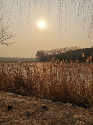 A beautiful sunset over a frozen lake in Haidian, Beijing: A beautiful sunset over a frozen lake in Haidian, Beijing