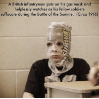 gas mask: A British infantryman puts on his gas mask and  helplessly watches as his fellow soldiers  suffocate during the Battle of the Somme. (Circa 1916)