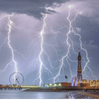 "Climbing, Memes, and Parents: A British photographer has scooped a global prize with his shot of lightning over Blackpool. Stephen Cheatley's picture depicts the Lancashire seaside resort during a storm and saw him beat 4,000 fellow snappers to Weather Photographer of The Year. Dan Matthewman took his photo on a climbing expedition to the French Alps, he won the over-17s category. Kathryn Parent's photo of a ""massive supercell"" won the the public's favourite award. photography weather weatherphotos bbcnews"