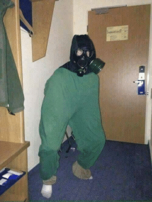 A British Solider Shelters from a German gas attack. (1916, colorized): A British Solider Shelters from a German gas attack. (1916, colorized)