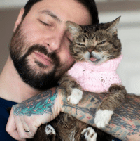 A BUB fan sent her this pink sweater. So we took a picture of it today. Happy Valentine's Day.: A BUB fan sent her this pink sweater. So we took a picture of it today. Happy Valentine's Day.
