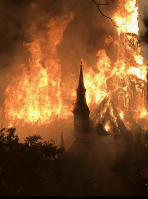 Church, Fire, and Lightning: A church consumed by fire after being struck by lightning.