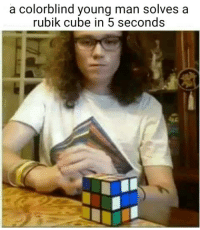 rubik cube: a colorblind young man solves a  rubik cube in 5 seconds