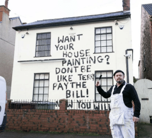 A disgruntled painter and decorator who claims he is owed £500 for his work has taken revenge - by leaving a message on the side of an old pub he had worked on.: A disgruntled painter and decorator who claims he is owed £500 for his work has taken revenge - by leaving a message on the side of an old pub he had worked on.