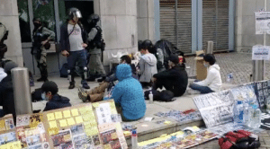 A group of Riot Police in Hong Kong have entered the UK consulate, and arrested a woman. This is a sit-in explicitly approved by the consulate, which means that the Police here is enforcing laws in UK territory.: A group of Riot Police in Hong Kong have entered the UK consulate, and arrested a woman. This is a sit-in explicitly approved by the consulate, which means that the Police here is enforcing laws in UK territory.