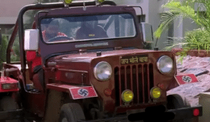 A guy just casually driving around a car with a Nazi flag: A guy just casually driving around a car with a Nazi flag