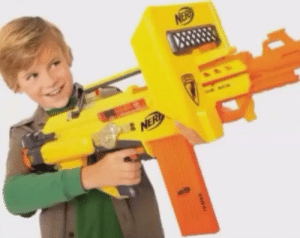 Hitler, April, and Youth: A Hitler Youth cadet proudly picks up his gun to fight the oncoming Russians during the Battle of Berlin to save the Third Reich (April 1945, Colourised)