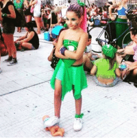 """A little girl in Argentina wearing """"Pro Abortion Green"""" stepping on a baby doll... because women's rights?: A little girl in Argentina wearing """"Pro Abortion Green"""" stepping on a baby doll... because women's rights?"""