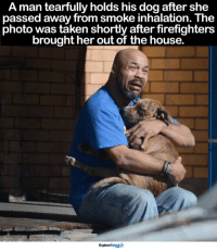 Dogs aren't just pets, they're family 😰💔: A man tearfully holds his dog after she  passed away from smoke inhalation. The  photo was taken shortly after firefighters  brought her out of the house.  Explore  Ar Dogs aren't just pets, they're family 😰💔