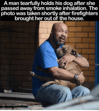 Dogs aren't just pets, they're family 😰💔: A man tearfully holds his dog after she  passed away from smoke inhalation. The  photo was taken shortly after firefighters  brought her out of the house. Dogs aren't just pets, they're family 😰💔