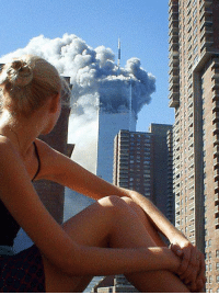 A model during a photo shoot distracted by first plane hitting the twin towers. #NeverForget https://t.co/TY3pmceJby: A model during a photo shoot distracted by first plane hitting the twin towers. #NeverForget https://t.co/TY3pmceJby