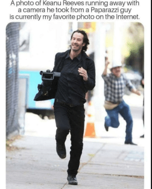Keanu Ran ;)): A photo of Keanu Reeves running away with  a camera he took from a Paparazzi guy  is currently my favorite photo on the Internet. Keanu Ran ;))