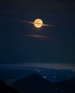 A picture taken when clouds surrounding the moon makes it look like Saturn.: A picture taken when clouds surrounding the moon makes it look like Saturn.