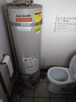 Thank You, Water, and Red: A.Q.Smith  EHergySavel  Compare the E  南不要丟紙在馬  Eery  ! D ] #  PLease don't Put the Pofe  in-to toiLet  asaling  NA ATNT o PENA PE  WARNING THIS WATER HEATER MUST 8BRACED  A RED CR TO AN PLUN OR MOYIN  INNGNFARTHOUAKE  Thank You  SEE  CTINSTALLATON PROCE STRUCTIONS FOR  18107-00 AEY  MRES  A DANGER  GiII This bathroom...