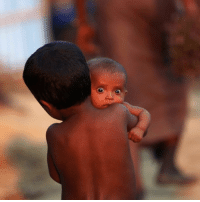 Memes, Muslim, and Help: A Rohingya Muslim child carries an infant at a refugee camp in Palang Khali near Cox's Bazar, Bangladesh. A UK charity appeal to help hundreds of thousands of people fleeing violence in Myanmar has been launched by the Disasters Emergency Committee (DEC). The government said it would match the first £3m donated by the public. More than 500,000 Rohingya Muslims have left the country, formerly known as Burma, with many now staying in makeshift camps in Bangladesh. PHOTO: REUTERS-Mohammad Ponir Hossain BBCSnapshot photojournalism photography charity Rohingya Muslims Myanmar Burma Bangladesh.