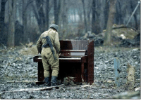 A Russian soldier playing an abandoned piano in Chechnya in 1994.: A Russian soldier playing an abandoned piano in Chechnya in 1994.