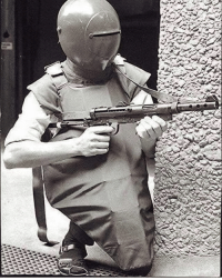 A Swedish police officer equipped with experimental body armor and the Carl Gustav submachine gun, 1970.: A Swedish police officer equipped with experimental body armor and the Carl Gustav submachine gun, 1970.