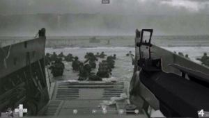 A U.S. Soldier surveys Normandy Beach before taking his first steps onto the shore. (June 6, 1944): A U.S. Soldier surveys Normandy Beach before taking his first steps onto the shore. (June 6, 1944)