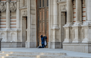 A Woman Prays At The Door Of Westminster Chapel, Unable To Attend Easter Service Due To Coronavirus: A Woman Prays At The Door Of Westminster Chapel, Unable To Attend Easter Service Due To Coronavirus