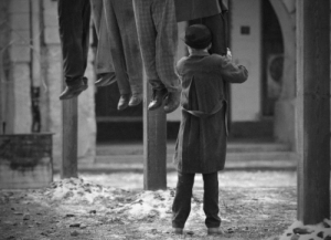 A young German boy hugging his mother's corpse after she was hanged for being anti-Nazi (1945): A young German boy hugging his mother's corpse after she was hanged for being anti-Nazi (1945)