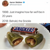 Chocolate, Peanuts, and How: Aaron Webber  @RubvEclipse  1998: Just imagine how far we'll be in  20 year  2018: Behold, the Snickle  T 1.86 02 (52.7g)  MILK CHOCOLATE PEANUTS CARAMEL NOUAT  EST BEFORE
