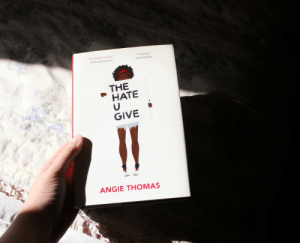 "Tumblr, Blog, and Book: Absolutely riveting""  JASON REYNOLDS  Stunning  JOHN GREEN  THE  HATE  GIVE  ANGIE THOMAS trinareadsbooks:  Read and Be Merry Book Photo Challenge Day 5: Fight for Something The Hate U Give is all about fighting for what is right and changing society in a way that makes it fair and just for everyone. I think that this is still a very important message that everyone needs to read and learn from."