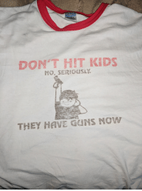 Guns, Kids, and Toosoon: ACTIVEWEAR  ULTRA  DONTHIT KIDS  THEY HAVE GUNS NO Had this shirt for eleven years. Gets better every year