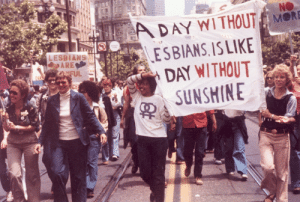 Chicago, Lesbians, and Taken: ADAY WITHOUT MORE  SESBIANS, ISLIKE  DAY WITHOUT  SUNSHINE  LESBIANS  PARE  FUL lesbianherstorian:  historicaltimes: Gay pride parade in Chicago, 1970s. i see this making the rounds frequently and i just want to correct the location and source - it was actually taken at the gay freedom day parade in san francisco, california, june 1979. the photo was published by the chicago tribune and the photographer remains unknown
