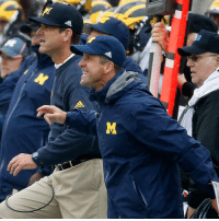 John Harbaugh hangs out with brother Jim on the sideline during the Michigan and Maryland game. BrotherGoals: adidas  0R John Harbaugh hangs out with brother Jim on the sideline during the Michigan and Maryland game. BrotherGoals