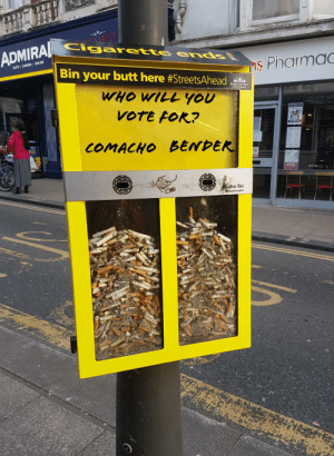 Littering deterrent: ADMIRA Cigarette ends  SLOTS I GAMING ONLINE  s Pharmac  Bin your butt here #StreetsAhead  Brighton & Hove  City Council  WHO WILL YOU  CAS  UATNA  VOTE FOR?  TRAV, FAST  COMACHO BENDER  REE  fe rallave  Ballot Bin  leatStreets Littering deterrent