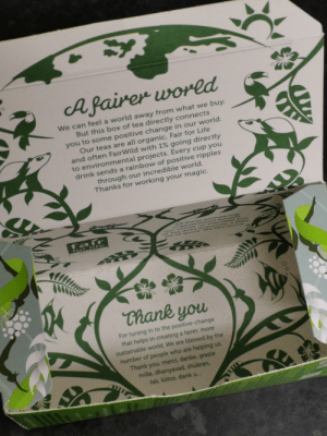 Blessed, Dank, and Life: Afairer wored  We can feel a world away from what we buy.  But this box of tea directly connects  you to some positive change in our world.  Our teas are all organic, Fair for Life  and often FairWild with 1% going directly  to environmental projects. Every cup you  drink sends a rainbow of positive ripples  through our incredible world.  Thanks for working your magic.  AIl these pioneering  orgaa nisation s benenE  Our world s O this little b OX  of te a d0es c veryyone a iCle  bit or go od w e lice go od  fafr  for life  Chank you  For tuning in to the positive-change  that helps in creating a fairer, more  sustainable world. We are blessed by the  number of people who are helping us.  Thank you, merci, danke, grazie  mille, dhanyavad, shukran,  tak, kiitos, dank u...  Oc A message at the bottom of a pukka tea box
