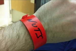 After a severe allergic reaction to walnuts, this is how the doctors labeled me at the hospital. People who looked at my wristband must've think I escaped the psych ward.: After a severe allergic reaction to walnuts, this is how the doctors labeled me at the hospital. People who looked at my wristband must've think I escaped the psych ward.